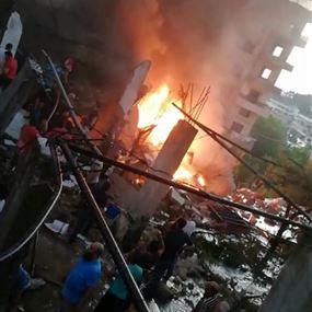 بالصور: إنفجار خزانات محطة وقود وسقوط جرحى