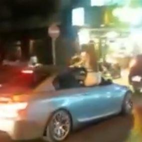 بالفيديو: رقَصَت شبه عارية على شباك السيارة في شارع الحمرا
