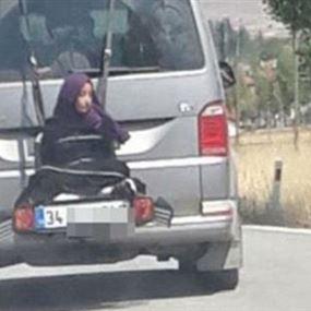 بالفيديو: ربط ابنته بمؤخرة السيارة وسار بها 400 متر!