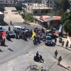 فيديو لمحاولة نزع صورة حسن غصن عند مدخل حي العرب