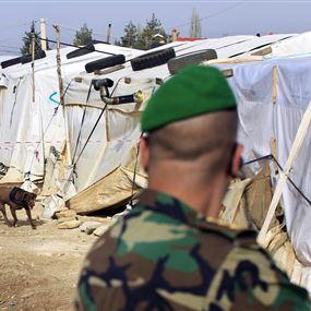 سوريون ومخزن بداخله كمية من الأسلحة والذخائر!